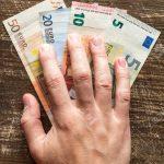 Bribery - Hand taking Euros